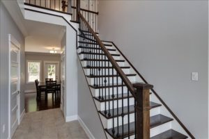 Craftsman newel post metal balusters and single left miter stair treads (Stair Parts Canada)
